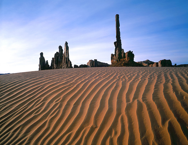 Totem Pole  and sand dunes in Monument Valley, Arizona, USA. .  John offers private photo tours and workshops throughout Colorado. Year-round. . John offers private photo tours in Monument Valley and throughout Arizona, Utah and Colorado. Year-round.