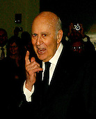 Carl Reiner responds to a reporter's question as he arrives for the eighth annual Mark Twain Prize for American Humor, which is being awarded this year to Steve Martin at the John F. Kennedy Center for the Performing Arts in Washington, D.C. on October 23, 2005.Credit: Ron Sachs / CNP