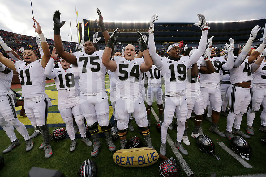 "Ohio State Buckeyes players sing ""Carmen Ohio"" following the NCAA football game against the Michigan Wolverines at Michigan Stadium in Ann Arbor on Nov. 25, 2017. Ohio State won 31-0. [Adam Cairns/Dispatch]"