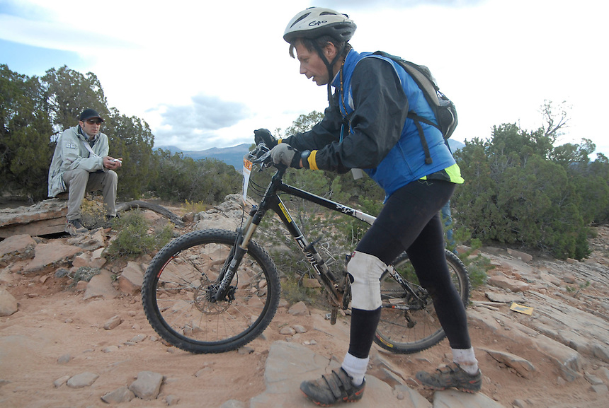 An obviously worn-out racer walks the rocky course of the 24 hours of Moab endurance mountain bike race.