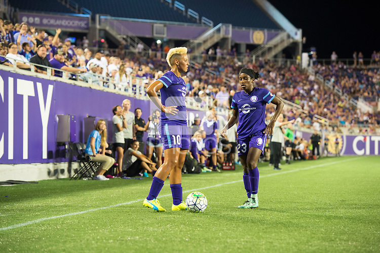 Orlando, Florida - Saturday, April 23, 2016: Orlando Pride forwards Lianne Sanderson (10) and Jasmyne Spencer (23) kill the final seconds of the clock during an NWSL match between Orlando Pride and Houston Dash at the Orlando Citrus Bowl.  Orlando defeated Houston 3-1.