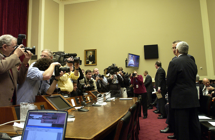 News photographers get photos of Mel Karmazin, president and chief operating officer, Viacom Inc. and Paul Tagliabue commissioner of the National Football League before the start of the Broadcast Decency Enforcement Act of 2004 subcommittee hearing.