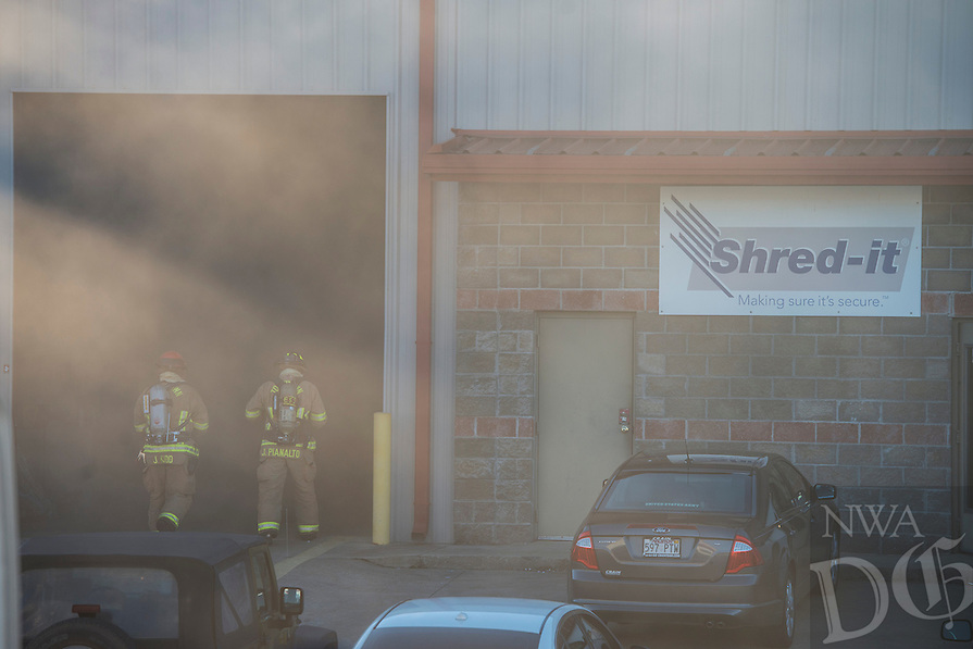 NWA Democrat-Gazette/ANTHONY REYES @NWATONYR<br /> Firefighters enter a smokey warehouse Monday, Jan. 16, 2017 at 413 Agnes Drive in Tontitown. Fire crews from Tontitown, Johnson, Weddington and Springdale Fire Departments respond to the structure fire. According to Todd Witzigman, division chief for Johnson Fire Department, the fire was focused in a floor drain that had plastic products in it. The cause of the fire is still under investigation. There were no injuries in the fire and damage was minimal.
