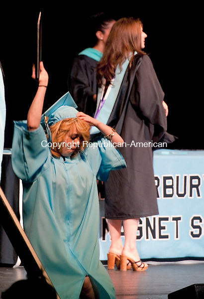 WATERBURY, CT-061714JS06--Graduate Jessenia Marie Torres proudly shoos offer diploma during Waterbury Arts Magnet School's graduation ceremonies Tuesday at the Palace Theater in Waterbury.<br />  Jim Shannon Republican-American