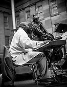 Allyn Johnson and Herman Burney play a tribute to jazz great Miles Davis ath the  Kogod Courtyard at the National Portrait Gallery in Washington, DC. <br /> <br /> PHOTOS/John Nelson