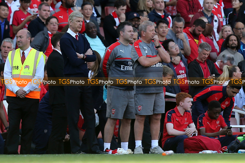 Arsenal manager Arsene Wenger watches from the side as his team parade around the pitch after Arsenal vs Everton, Premier League Football at the Emirates Stadium on 21st May 2017