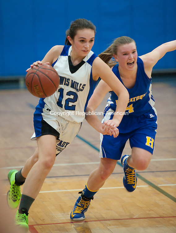 BURLINGTON, CT-011714JS05- Lewis Mills' Natalie Ruel (12) drives past Housatonic's Heather Kearns (4) during their game Friday at Lewis S. Mills High School in Burlington. <br /> Jim Shannon Republican-American