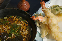 Tempura Soba - Soba is a type of thin Japanese noodles made from buckwheat flour. It is served either chilled with a dipping sauce, or in hot broth as a noodle soup.  In Japan, soba noodles are served in a variety of situations. They are a popular inexpensive fast food at train stations throughout Japan and are served by exclusive and expensive specialty restaurants. Markets sell dried noodles and men-tsuyu, or instant noodle broth, to make home preparation easy.