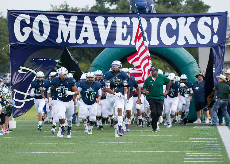 The McNeil Mavericks take the field for a high school football game between McNeil High School and Harker Heights High School at Kelly Reeves Stadium in Round Rock on Thursday, September 1, 2016.