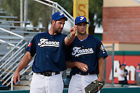 20 September 2012: Eric Gagne talks to pitcher Quentin Pourcel prior to Spain 8-0 win over France, at the 2012 World Baseball Classic Qualifier round, in Jupiter, Florida, USA.
