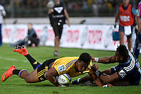 Julian Savea (Hurricanes ) and Lolagi Visinia ( Blues ) in action during the Super Rugby - Hurricanes v Blues at FMG Stadium, Palmerston North, New Zealand on Friday 13 March 2015. <br />