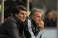 Saturday, 08 December 2012<br /> Pictured L-R: Disappointment in the faces of Swansea manager Michael Laudrup and assistant coach Alan Curtis<br /> Re: Barclays Premier League, Swansea City FC v Norwich City at the Liberty Stadium, south Wales.