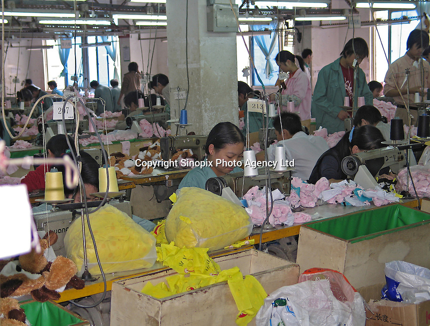 A sweat-shop style factory in an old district of Dongguan, China. The factory makes soft toys for many companies and biggest client is Wal-mart..24 Nov 2004