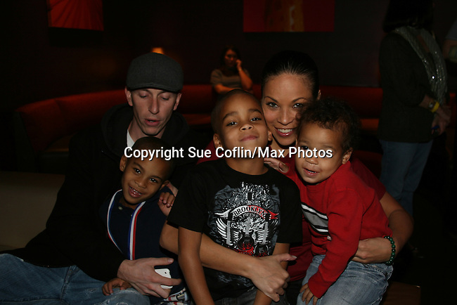 One Life To Live's Daphnee Duplaix & boyfriend Nino Balisteri & kids - twins Sebastian and Jaylen and brother Jaxson (R) at the 2009 Daytime Stars and Strikes to benefit the American Cancer Society to benefit the American Cancer Society on October 11, 2009 at the Port Authority Leisure Lanes, New York City, New York. (Photo by Sue Coflin/Max Photos)