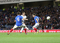 Chris Mitchell shoots between Lee McCulloch (left) and Ian Black in the Rangers v Queen of the South Quarter Final match in the Ramsdens Cup played at Ibrox Stadium, Glasgow on 18.9.12. .