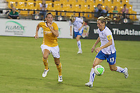 Kristine Lilly (13) of the Boston Breakers and Rebecca Nolin (19) of the Atlanta Beat. The Boston Breakers defeated the Atlanta Beat 3-1 during a Women's Professional Soccer (WPS) match at KSU Atlanta Beat Stadium Kennesaw, GA, on August 28, 2010.