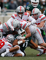 Ohio State Buckeyes linebacker Tuf Borland (32) and Ohio State Buckeyes linebacker Malik Harrison (39) combine for a tackle on Michigan State Spartans running back Connor Heyward (11) during the first quarter of a NCAA college football game between the Michigan State Spartans and the Ohio State Buckeyes on Saturday, November 10, 2018 at Spartan Stadium in East Lansing, Michigan. [Joshua A. Bickel/Dispatch]