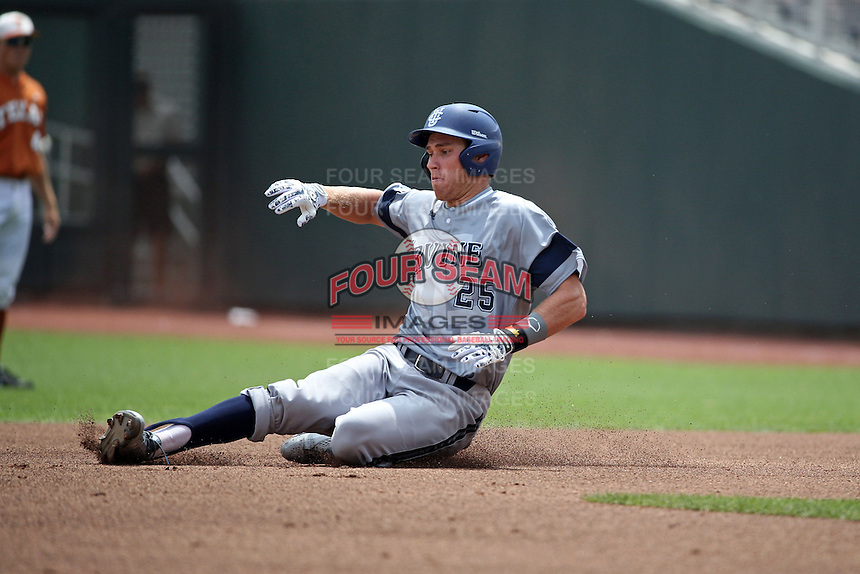 Taylor Sparks #25 of the UC Irvine Anteaters slides during Game 1 of the 2014 Men's College World Series between the UC Irvine Anteaters and Texas Longhorns at TD Ameritrade Park on June 14, 2014 in Omaha, Nebraska. (Brace Hemmelgarn/Four Seam Images)