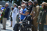 Washington, DC - June 6, 2014: In remembrance of the 70th anniversary of the D-Day invasion,  WWII veteran Henry Mendoza (seated) participates in a wreath laying ceremony at the National World War II Memorial  in the District of Columbia. Mendoza was a member of the 9th Air Force in the months leading up to Operation Overlord.  (Photo by Don Baxter/Media Images International)