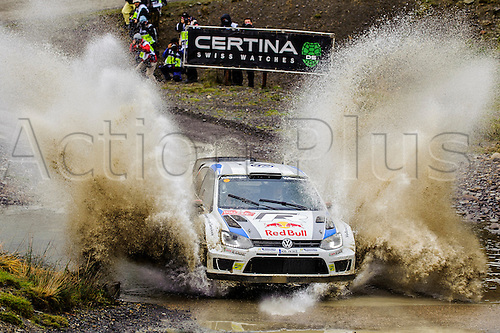 15.11.2013 Powys, Wales. Jari-Matti Latvala and Miikka Anttila of Finland (FIN) drive their VOLKSWAGEN MOTORSPORT Volkswagen Polo R WRC through the water splash on the first pass of the Sweet Lamb stage (SS5) during Day 2 of Wales Rally GB, the final round of the 2013 FIA Word Rally Championship.