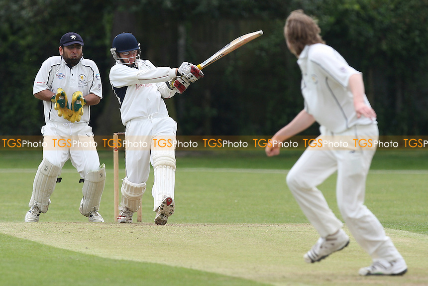 F Butt looks on as A D'Cruz of Ardleigh Green hits out - Upminster CC vs Ardleigh Green CC - National Club Championship 1st Round - 16/05/10 - MANDATORY CREDIT: Gavin Ellis/TGSPHOTO - Self billing applies where appropriate - Tel: 0845 094 6026