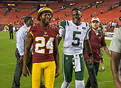 Washington Redskins defensive back Josh Norman (24) and New York Jets quarterback Teddy Bridgewater (5) leave the field together following the game at FedEx Field in Landover, Maryland on Thursday, August 16, 2018.  The Redskins won the game 15 - 13.<br /> Credit: Ron Sachs / CNP<br /> (RESTRICTION: NO New York or New Jersey Newspapers or newspapers within a 75 mile radius of New York City)