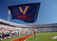 Oct 2, 2010; Charlottesville, VA, USA; A cheerleader holds a Virginia Cavaliers flag during the game against Florida State at Scott Stadium. Florida State won 34-14.  Mandatory Credit: Andrew Shurtleff