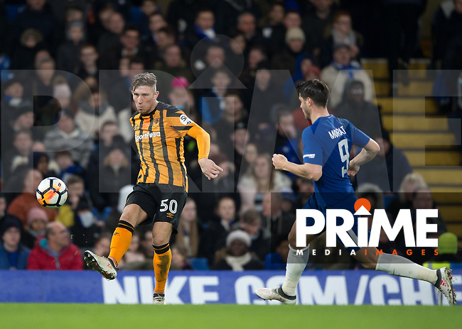 Augus MacDonald of Hull City clears the ball from Álvaro Morata of Chelsea during the FA Cup 5th round match between Chelsea and Hull City at Stamford Bridge, London, England on 16 February 2018. Photo by Vince  Mignott / PRiME Media Images.
