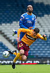 Motherwell v St Johnstone.....16.04.11  Scottish Cup Semi-Final.Michael Duberry fouls John Sutton.Picture by Graeme Hart..Copyright Perthshire Picture Agency.Tel: 01738 623350  Mobile: 07990 594431