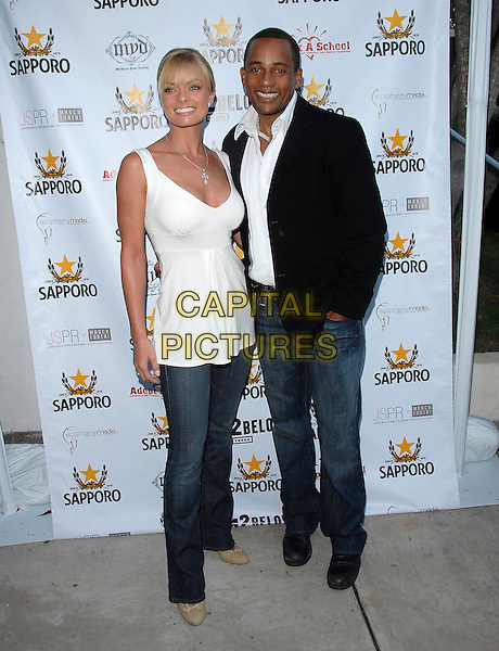 "JAIME PRESSLEY & HILL HARPER.attends The Launch of their ""Adopt-a-School Initiave"" held at RJ Cutler's Estate in The Hollywood Hills, California, USA, August 12, 2006..full length jamie white top jeans.Ref: DVS.www.capitalpictures.com.sales@capitalpictures.com.©Debbie VanStory/Capital Pictures"