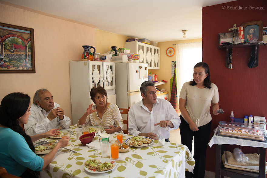"""Donovan celebrates his 43rd birthday with his family at his home in Texcoco, Mexico on May 9, 2015. Donovan Tavera, 43, is the director of """"Limpieza Forense México"""", the country's first and so far the only government-accredited forensic cleaning company. Since 2000, Tavera, a self-taught forensic technician, and his family have offered services to clean up homicides, unattended death, suicides, the homes of compulsive hoarders and houses destroyed by fire or flooding. Despite rising violence that has left 70,000 people dead and 23,000 disappeared since 2006, Mexico has only one certified forensic cleaner. As a consequence, the biological hazards associated with crime scenes are going unchecked all around the country. Photo by Bénédicte Desrus"""