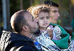 Yalsin Nakasha, a refugee from Daraa, Syria, kisses his daughter Zahara, 3, after the family arrived safely on the shores of the Greek island of Lesbos just minutes earlier. Along with his wife and two daughters, he is heading for Sweden, and crossed the Aegean Sea in a small overloaded raft.