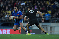 France's Teddy Thomas steps inside NZ's Anton Lienert-Brown during the Steinlager Series international rugby match between the New Zealand All Blacks and France at Westpac Stadium in Wellington, New Zealand on Saturday, 16 June 2018. Photo: Dave Lintott / lintottphoto.co.nz