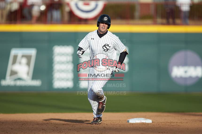 Wes Clarke (28) of the South Carolina Gamecocks rounds the bases after hitting a home run against the Holy Cross Crusaders at Founders Park on February 15, 2020 in Columbia, South Carolina. The Gamecocks defeated the Crusaders 9-4.  (Brian Westerholt/Four Seam Images)