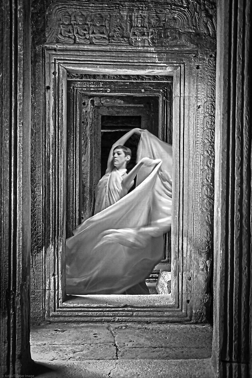 A young woman dancing with veils at Angkor Wat Temple in Cambodia