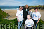 Shannon Brady has neurofibromatosis, a rare neurological condition caused by a single gene mutation that sees tumours grow along various types of nerves, with her family  was in Ballybunion on Tuesday to support Children with Tumours Ireland Neurofibromatosis awareness day Pictured  Tony Brady (dad) Alison Brady (mom) and brother Danny Brady with  resident Beach Artist Mario Perez