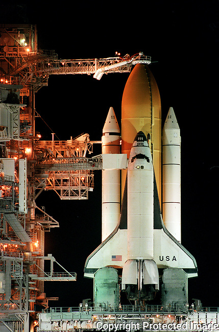 The Space Shuttle Columbia sits atop launch pad 39-B at Kennedy Space Center, Wednesday, April 15, 1998, prior to the scheduled launch of STS-90 on Thursday.  The launch was postponed due to an electronic glitch and rescheduled for Friday, April 16, 1998.(Brian Myrick)..P2C