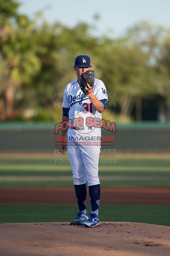 AZL Dodgers starting pitcher James Marinan (31) looks in for the sign during an Arizona League game against the AZL White Sox at Camelback Ranch on July 3, 2018 in Glendale, Arizona. The AZL Dodgers defeated the AZL White Sox by a score of 10-5. (Zachary Lucy/Four Seam Images)