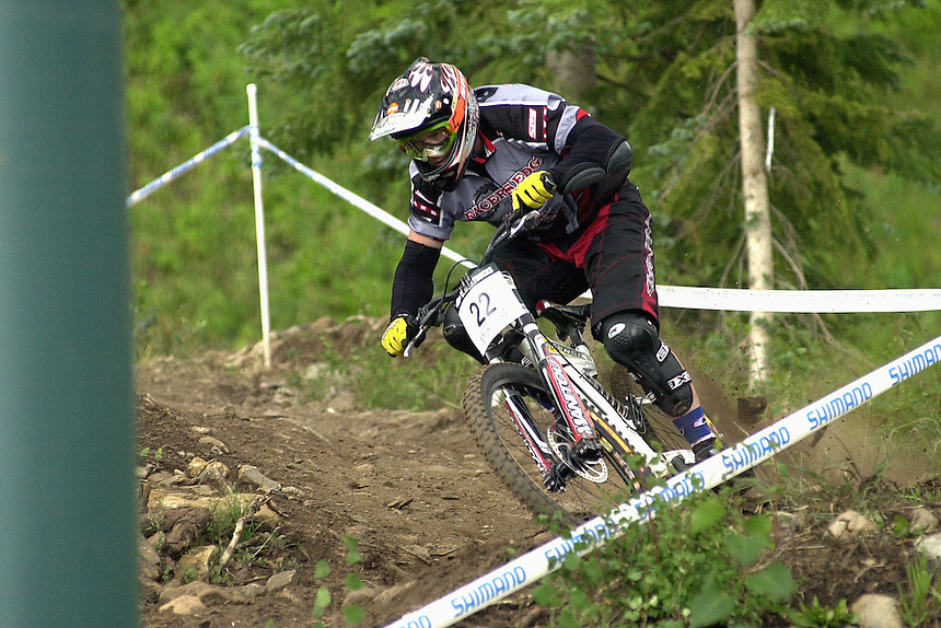 Downhill racer Todd Bosch rides the Durango Mountain Resort downhill course in August 2002.