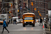 A school bus in seen during operation on a street in New York. 01/15/2013. .Drivers of yellow school buses in New York are planning to go on strike tomorrow Wednesday, leaving more than150,000 children looking for a new way to get to school. Photo by Eduardo Munoz Alvarez / VIEW.