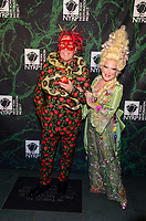 NEW YORK, NY - OCTOBER 30: Michael Kors (L) and Bette Midler attend Bette Midler's Annual Hulaween Event Benefiting The New York Restoration Project, at the Cathedral of St. John the Divine on Monday, October 30, 2017  in New York. Credit: Raymond Hagans/MediaPunch /NortePhoto.com