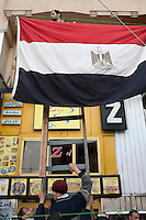 Protesters rig up an Egyptian flag in Tahrir Square. Continued anti-government protests take place in Cairo calling for President Mubarak to stand down. After dissolving the government, Mubarak still refuses to step down from power.