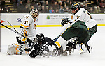 30 November 2009: University of Vermont Catamount goaltender Mike Spillane, a Senior from Bow, NH, makes a second period stop against the Yale University Bulldogs at Gutterson Fieldhouse in Burlington, Vermont. Spillane made 26 saves to lead the Catamounts to a 1-0 shutout in a rematch of last season's first round of the NCAA post-season playoff Tournament. Mandatory Credit: Ed Wolfstein Photo