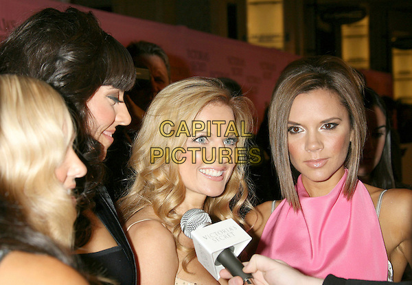 SPICE GIRLS - Emma Bunton, Melanie Chisholm, Geri Halliwell and Victoria Beckham.2007 Victoria's Secret Fashion Show Arrivals .held at the Kodak Theatre, Hollywood, California, .USA, 15 November 2007..The Mel C baby sporty ginger posh spice half length microphone being interviewed profile.CAP/ADM/RE.©Russ Elliot/AdMedia/Capital Pictures.