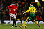 Aaron Wan-Bissaka of Manchester United passes the ball past Sam Byram of Norwich City during the Premier League match at Old Trafford, Manchester. Picture date: 11th January 2020. Picture credit should read: James Wilson/Sportimage