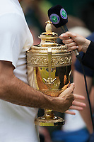 Roger Federer (SUI) holds the Wimbledon Mens Trophy during the post match interview, Wimbledon Championships 2017, Day 13, Mens Final, All England Lawn Tennis & Croquet Club, Church Rd, London, United Kingdom - 16th July 2017
