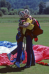 Woman hugging Instructor after tandem jump from airplane and a safe landing landing