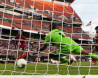 CLEVELAND, OH - JUNE 22: Marvin Phillip #1 attempts a save on Aaron Long's #23 header during a game between the United States and Trinidad & Tobago at FirstEnergy Stadium on June 22, 2019 in Cleveland, Ohio.