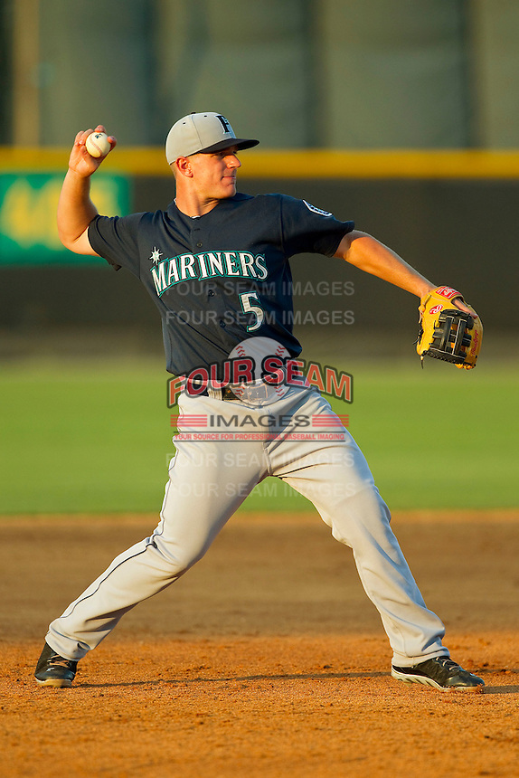 Pulaski Mariners third baseman Joseph DeCarlo (5) makes a throw to first base against the Burlington Royals at Burlington Athletic Park on June20 2013 in Burlington, North Carolina.  The Royals defeated the Mariners 2-1 in 13 innings.  (Brian Westerholt/Four Seam Images)