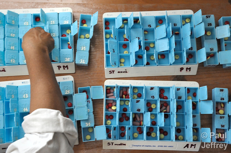 """Medicines, including antiretroviral drugs, get sorted into individual boxes before being administered to patients living in the """"House for the Dying"""", a hospice for AIDS patients and other terminally ill patients run by the Sisters of Charity in Port au Prince, Haiti."""